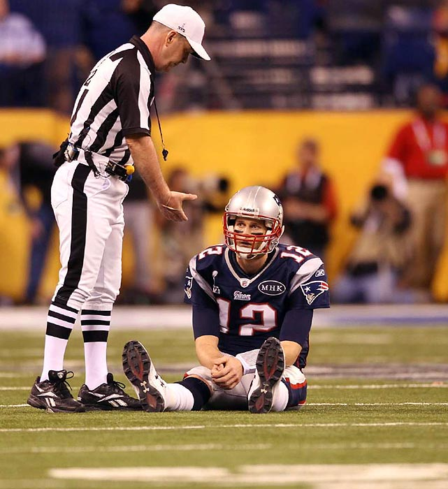 Brady sitting on the field